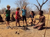 Kids and Bushman in the Kalahari