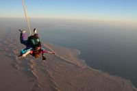 Sky dive over the dunes and ocean
